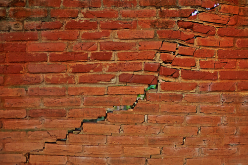 cracked-brick-wall